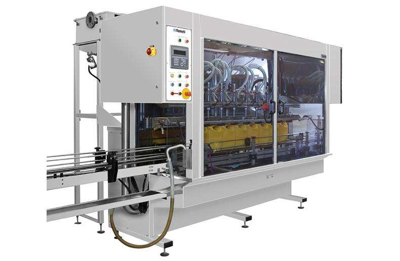 Adelphi Masterfil automatic filling and capping machine