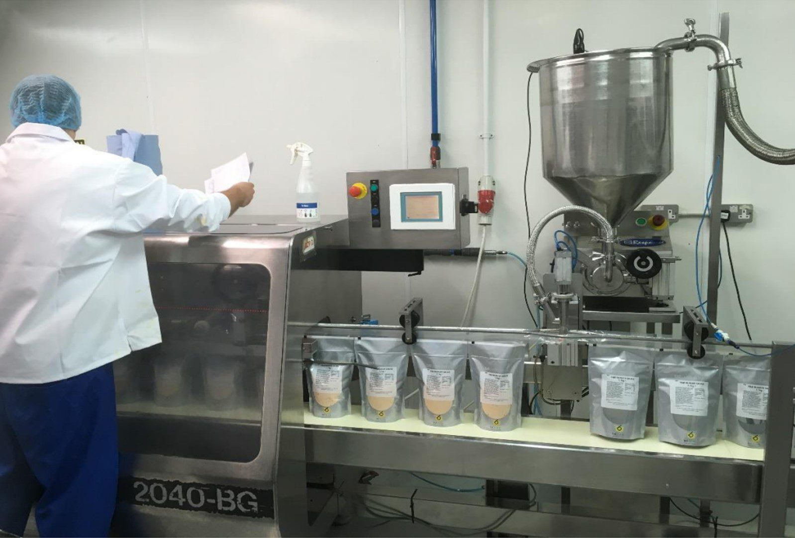 Integrating a filling machine into a form fill and seal line